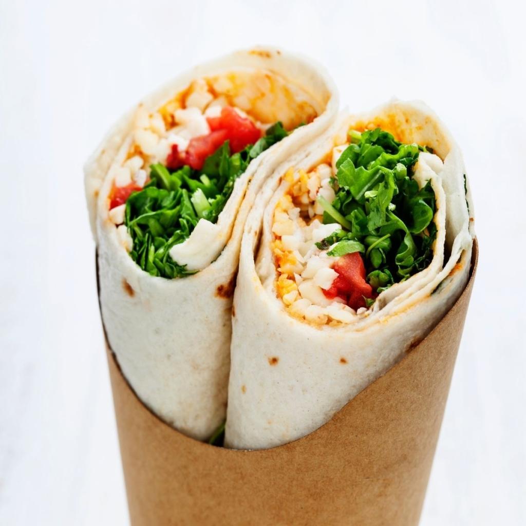 Chicken wrap lunch, sliced in half.